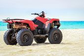 Quad vehicle on empty caribbean beach against caribbean sea background poster