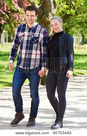 Attractive Trendy Couple Enjoying A Walk