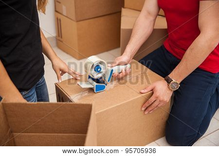Couple Packing Some Boxes