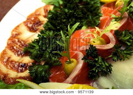 Appetizer made of meat and fish served with salad poster