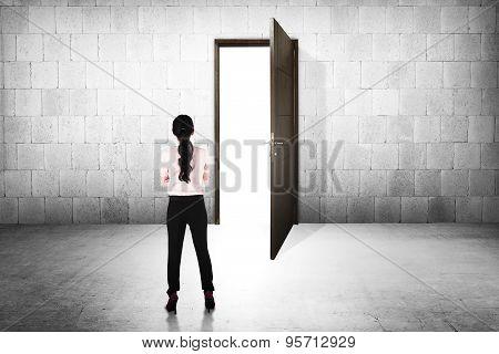 Business Woman Going To The Open Door