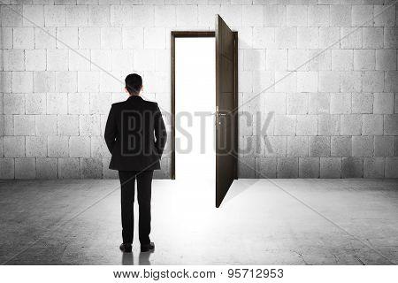 Business Man Going To The Open Door