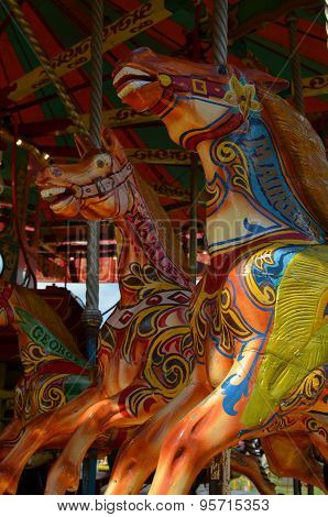 Fairground galloping horses.