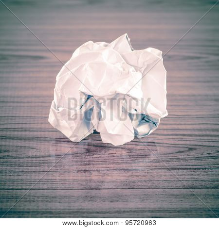 white crumpled paper on wood table background