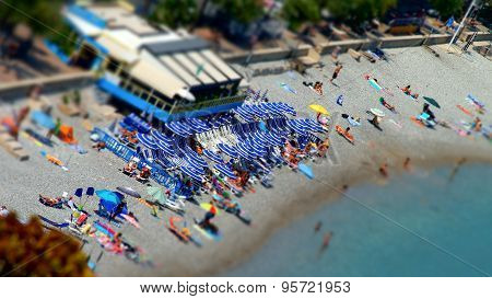 Tilt-shift view of the beach in Menton France touristic concept poster