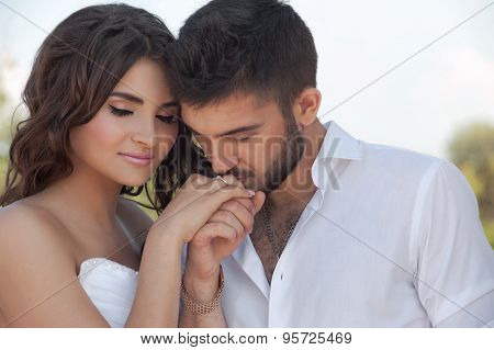 Groom in white shirt kiss bride hand. Very gentle photo.Valentine day