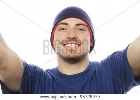 Tehnology and people concept: Happy selfie. Handsome young man holding camera and making selfie and smiling.