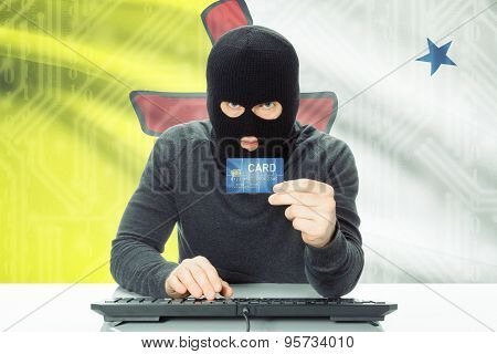 Hacker Holding Credit Card And Canadian Province Flag On Background - Nunavut
