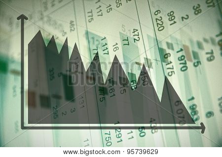 Downtrend diagram and financial data on PC screen