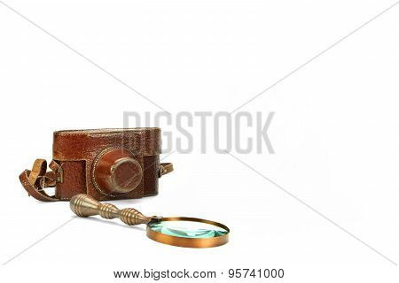 Old Shabby Slr Photo Camera Case And Magnifying Glass Isolated