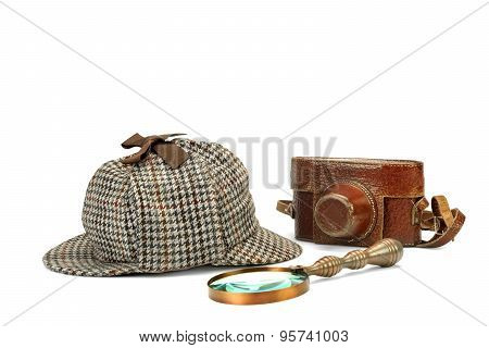 Sherlock Holmes Deerstalker Cap, Vintage Magnifying Glass And Retro Camera