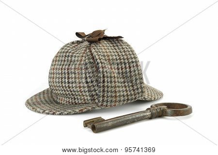 Sherlock Holmes Deerstalker Cap And Old Vintage Big Key Isolated