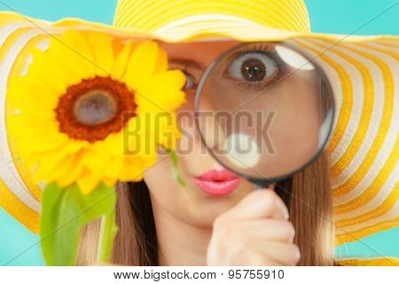 Botanist Woman With Sunflower And Magnifying Glass