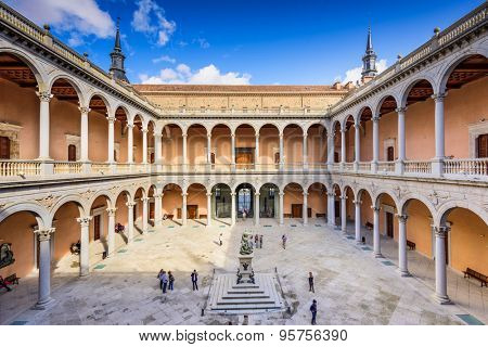 TOLEDO, SPAIN - NOVEMBER 11, 2014: Alcazar of Toledo, Spain at the interior courtyard. Once used as a Roman palace, the Spanish rebuilt the Alcazar in the 16th Century.