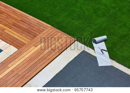 Artificial grass turf installation in deck garden with tools and joint roll poster