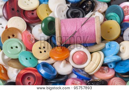 Pile Of Old Colored Buttons With Thread And Needle