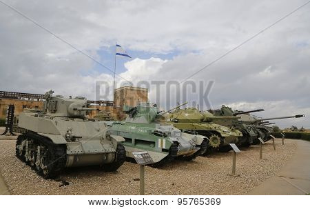 Light tanks with an American made light tank M5A1 Stuart in front on display