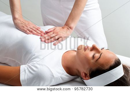 Therapist Pressing With Hands On Womans Chest At Reiki Session.