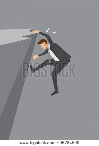 Man Clinging On Edge Of Cliff