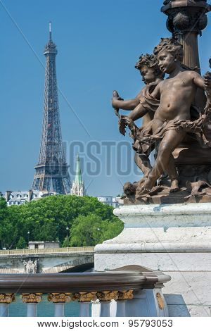 Ornate renaissance street lamp on the famous Pont Alexandre III bridge in central Paris with River Seine and Eiffel Tower in the distance. Ronde d'Amours wearing garlands among winged fish (1900). poster