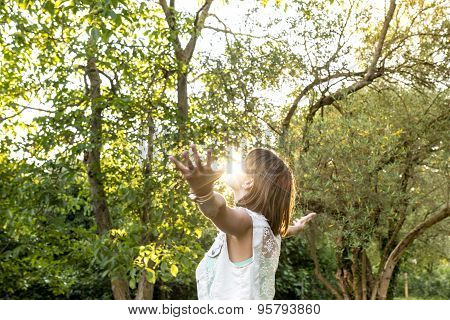Young Woman Meditating And Embracing Her Beautiful Life  Standing With Her Arms Outspread