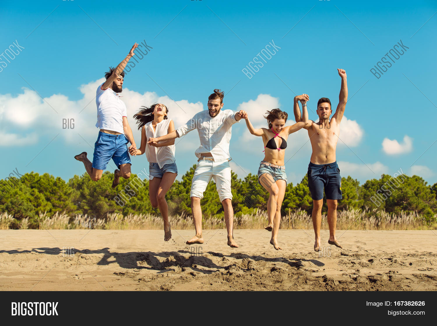 Group Of Friends Together On The Beach Having Fun Happy Young People Jumping