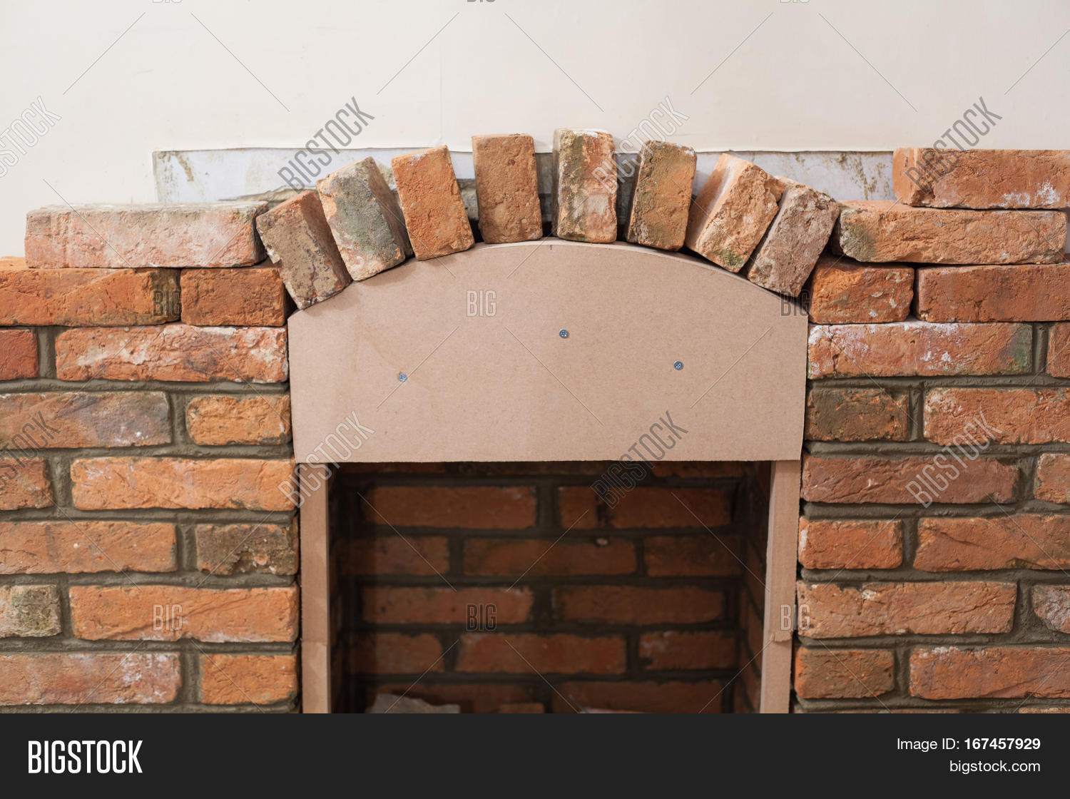 Indoor Diy Project Building Fireplace In The House Laying Bricks Template For Arch