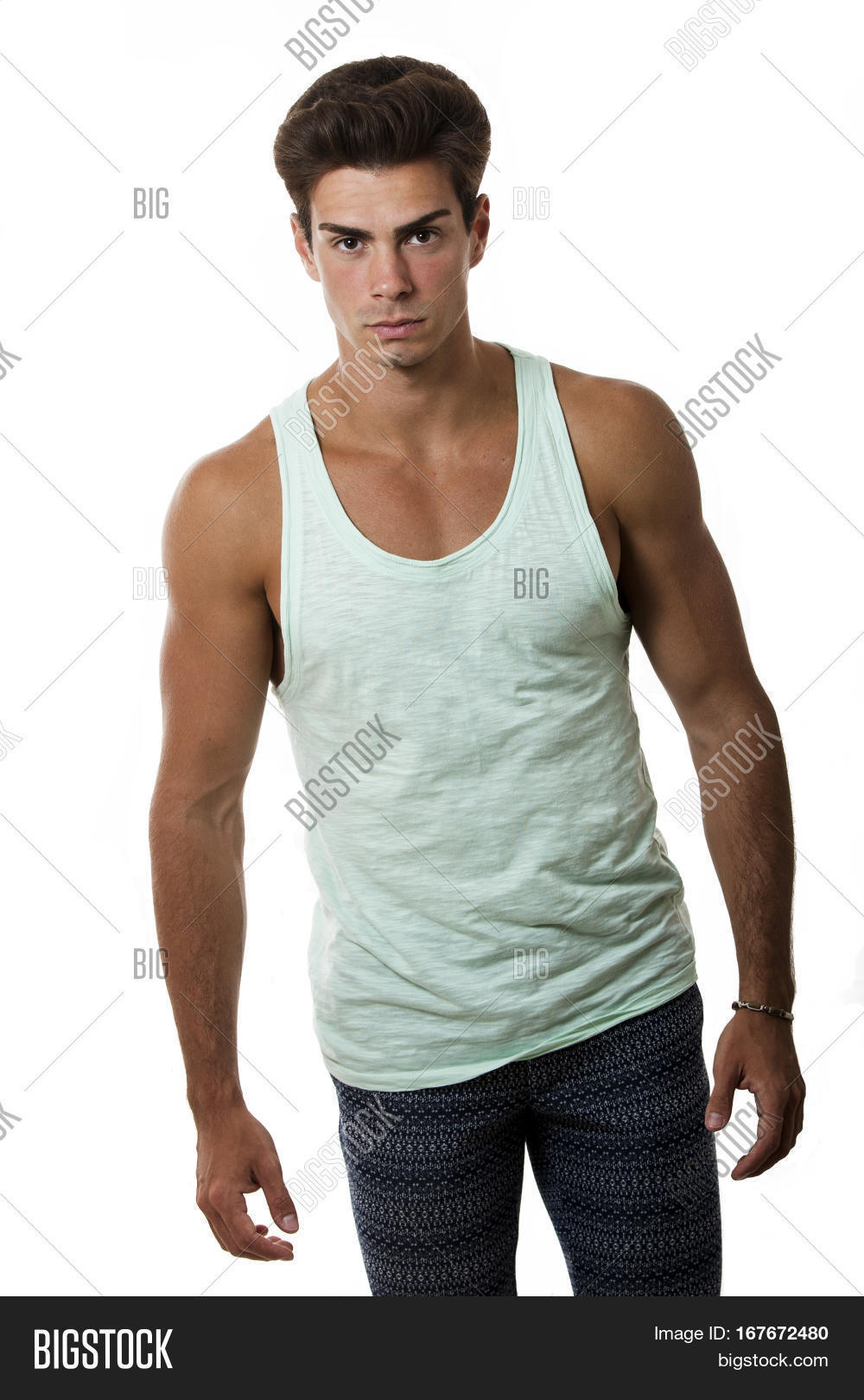 c4e40307b24f1 Handsome guy in tank top and leggings on white background . Stylish hair. A  charming