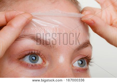 Woman Removing Facial Peel Off Mask Closeup
