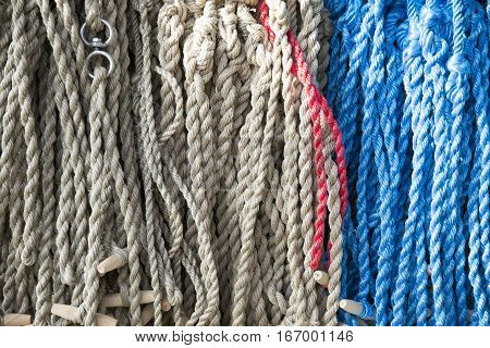 Gray white and blue colored rope hanging on market for sale