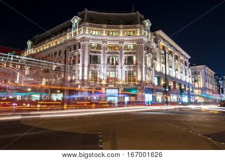 Night view on a corner building in one of the busiest streets in london
