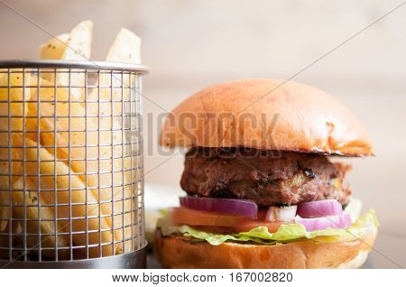 Burger And Fries On A White Cafe Background