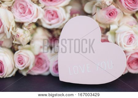 Love heart and bright pink roses background