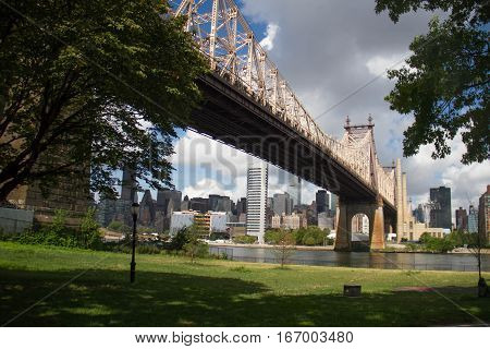 Queensboro bridge over the river and buildings in Manhattan, New York