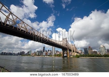 Queensboro bridge over the river with cloudy sky