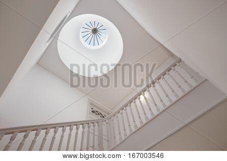 Beautiful Stairwell With a Bright Ornamented Skylight