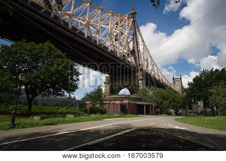 Queensboro bridge and the street at the park, New York
