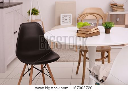 Neutral interior with table on gray wall background