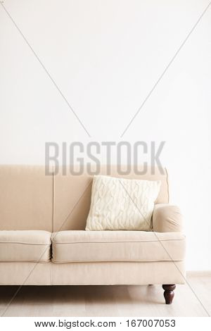 New cozy couch  on light wall background