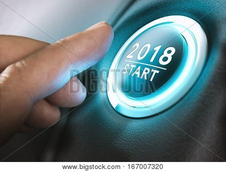 Hand pressing a 2018 start button. Concept of new year two thousand eighteen. Composite between a photography and a 3D background. Horizontal image