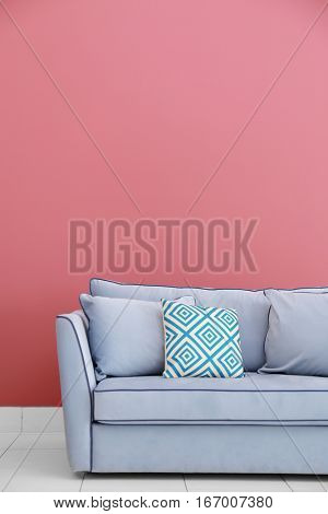 Modern couch on red wall background