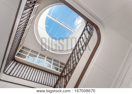 A Beautiful Stairwell With a Bright Skylight