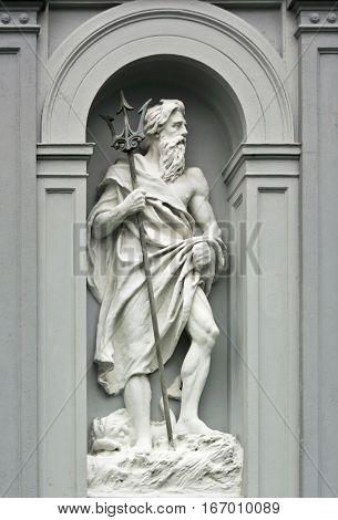 Fragment of building with sculpture of Neptune in Bergen, Norway