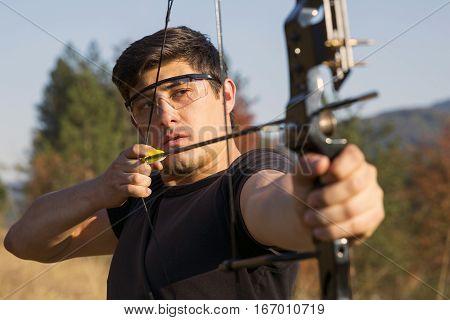 Archer Draws His Compound Bow