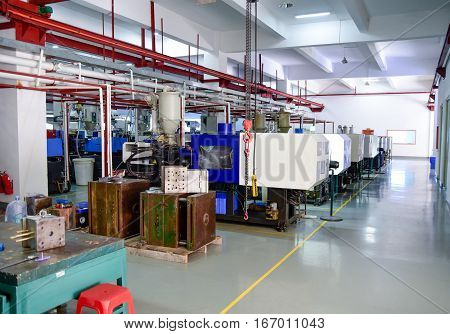 Workshop with a row of CNC machines