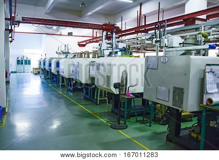 Workshop area with a row of CNC machines