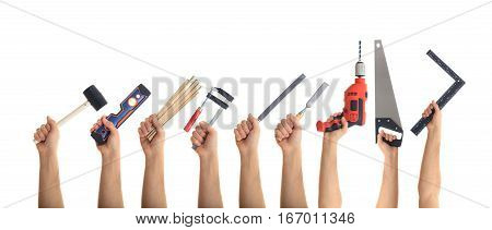 Hands Holding Tools On White Background