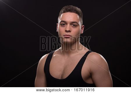 Man Tired Muscular, Good Looking, Sleeveless T-shirt Posing