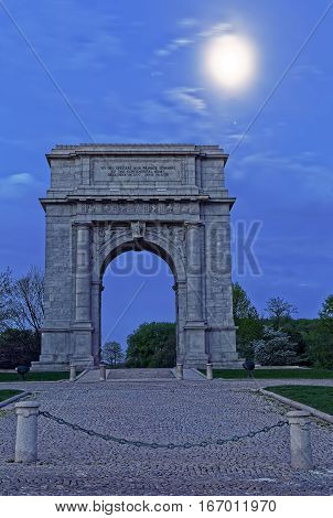 Springtime predawn moonlight at Valley Forge National Historical Park in Pennsylvania USA.The National Memorial Arch is a monument dedicated to George Washington and the United States Continental Army.