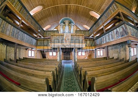 Empty Interior of wooden Articular Church of Svaty Kriz in Slovakia with fisheye lens